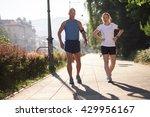 jogging couple check music... | Shutterstock . vector #429956167