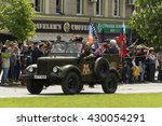 Small photo of Donetsk People Republic, Ukraine. 2016, May 9. - Russian military veterans of World War II riding in the old car along Artema street during Victory Parade in Donetsk. Crowd, Flowers, Flag of Russia.