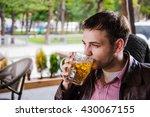 man drinks beer. side view of... | Shutterstock . vector #430067155
