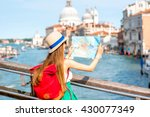 young female traveler with hat... | Shutterstock . vector #430077349