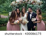 Newlyweds And Bridesmaids With...