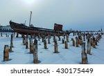 old rusty ship on winter shore... | Shutterstock . vector #430175449
