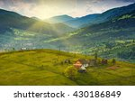 Stock photo laseshina village on a mountain hill covered with fresh green grass in a sunset light carpathian 430186849
