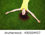 cheerful woman wearing bright... | Shutterstock . vector #430204927