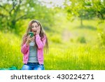 sitting girl with phone | Shutterstock . vector #430224271