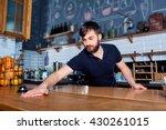 bartender wiping down bar...   Shutterstock . vector #430261015