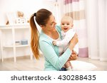mother and her little baby at... | Shutterstock . vector #430288435