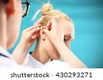 hearing aid. the doctor assumes ... | Shutterstock . vector #430293271