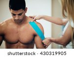 physical therapist placing... | Shutterstock . vector #430319905