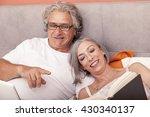mature couple relaxing in bed... | Shutterstock . vector #430340137