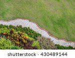 Gardening, landscaping, small trees planted many different kinds of color combinations. White Rock made a small corridor curves - stock photo