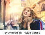 happy woman doing shopping | Shutterstock . vector #430598551