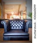 one seat black leather sofa