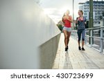women jogging in city in dusk... | Shutterstock . vector #430723699