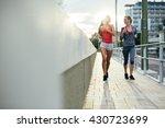 women jogging in city in dusk... | Shutterstock . vector #430723699