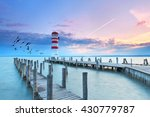Lighthouse At Sunset In...