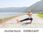 young female stretching by the... | Shutterstock . vector #430861669