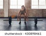 female performing deadlift... | Shutterstock . vector #430898461