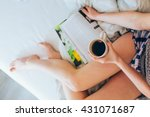 young woman lying in bed... | Shutterstock . vector #431071687
