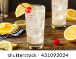 Stock photo refreshing classic tom collins cocktail with a cherry and lemon slice 431092024