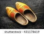 Dutch Wooden Shoes On A Black...
