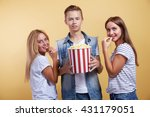 three young people with popcorn | Shutterstock . vector #431179051