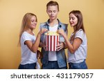 three young people with popcorn | Shutterstock . vector #431179057