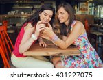 Two Girls In A Coffee Shop ...