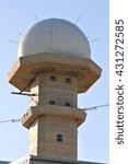 Small photo of An air traffic control radar tower at an airport.