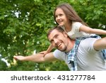 Father With Daughter In Summer...