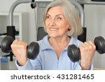 elderly woman exercising in gym | Shutterstock . vector #431281465