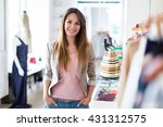 woman in her clothing boutique  | Shutterstock . vector #431312575