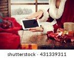Santa Claus Woman And Tablet