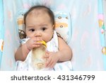 cute baby suck milk from bottle | Shutterstock . vector #431346799