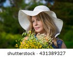 pretty woman with flowers | Shutterstock . vector #431389327
