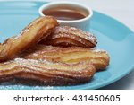 Churros On Blue Plate With...