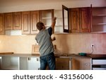 Stock photo carpenter working on new kitchen cabinets 43156006