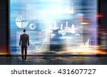 Businessman looking at abstract business chart and puzzle pieces with people silhouettes on blurry city background. Concept of business management and teamwork - stock photo