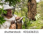Bee Keeper With A Swarm Of...