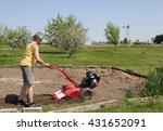 woman gardener with a gas...   Shutterstock . vector #431652091