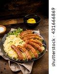 Small photo of Nuremberg sausage with sauerkraut and mustard