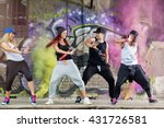 Stock photo young modern dancing group practice dancing in front colorful wall 431726581