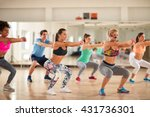 Small photo of Fitness group doing exercises for shaping breech on fitness class