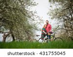 happy young couple with bikes... | Shutterstock . vector #431755045