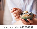 young woman with muesli bowl.... | Shutterstock . vector #431914957