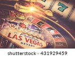 Stock photo las vegas gambling concept roulette slot machine and las vegas welcoming strip sign playing in a 431929459