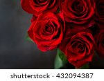 Stock photo bouquet of red roses on a black background top view 432094387