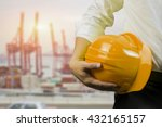 Small photo of engineering management construction ,engineer hold in hand yellow helmet for workers security on working site background. busines concept,selective focus,vintage tone