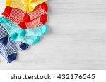baby socks on wooden background | Shutterstock . vector #432176545