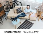 young man relaxing on sofa ... | Shutterstock . vector #432218599